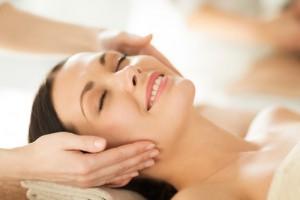 smiling woman getting facial
