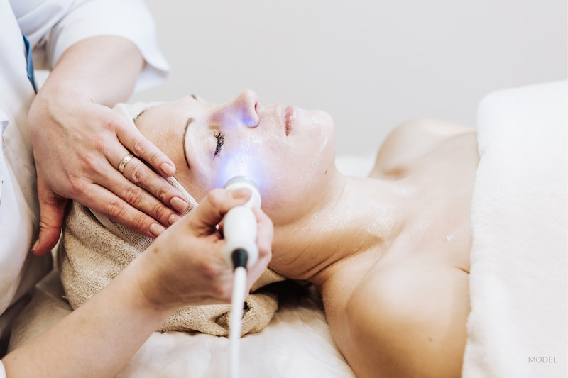 Woman getting laser treatment.